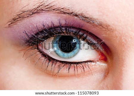 Detailed photo of a blue woman eye - stock photo