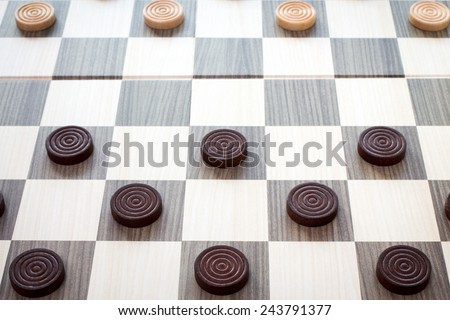 Detailed photo of the checkers board game - stock photo