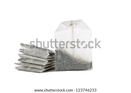 Detailed shot of stack of teabags isolated on white background. - stock photo
