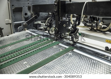 detailed view of a sheetfed offset printing machine  - stock photo