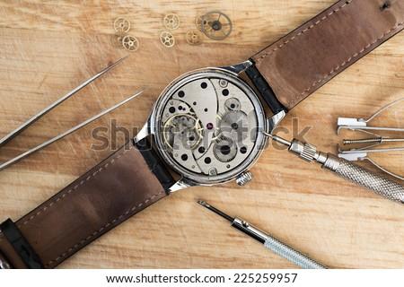 Details for repair of clocks - stock photo