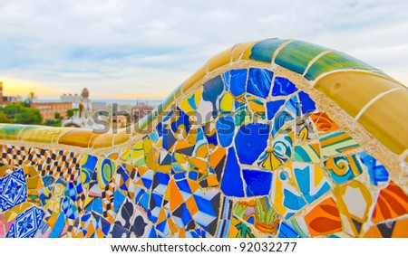 Details of a colorful ceramic bench at Parc Guell designed by Antoni Gaudi, Barcelona, Spain. - stock photo