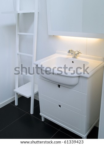 Details of a modern trendy contemporary designer bathroom in all white elements - stock photo