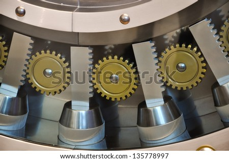 details of a safe door, showing gears and bolts - stock photo