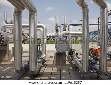 Details of a valve or pump that is part of a complex industrial pipeline system. - stock photo