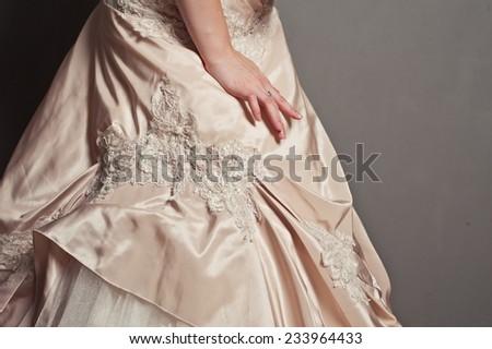 Details of a wedding dress close up. - stock photo