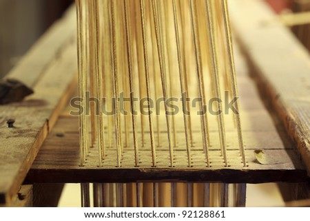 Details of a wooden damask weaving machine - stock photo