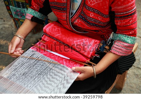 Details of an ethnic minority hand loom weaver in Guangxi, China - stock photo