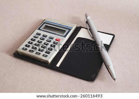 Details of an old and dirty calculator.  - stock photo