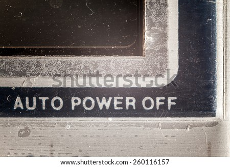 Details of an old used calculator, view on message about powering off automatically.  - stock photo