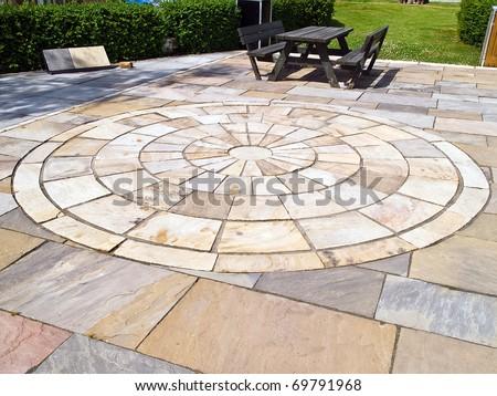 Details of circle design stone floor tiles for outdoors garden - stock photo