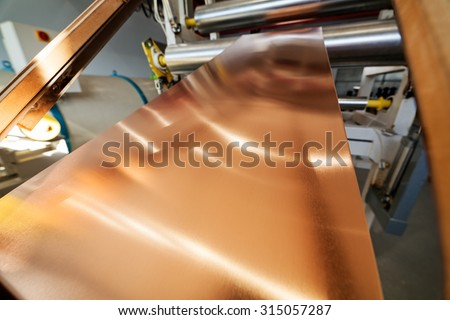 details of copper foil bending machine in high voltage transformer making plant - stock photo