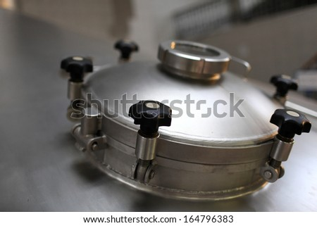 Details of fermentation vat of a brewery - stock photo