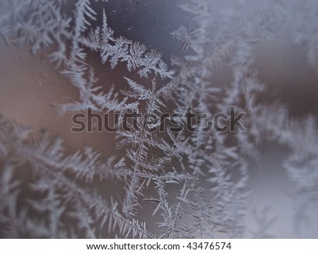 Details of ice crystals on a window shallow DOF winter background - stock photo