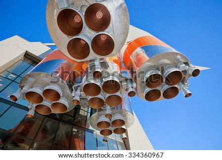 Details of space rocket engine over blue sky background - stock photo