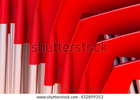details of stack red chairs from hard plastic. abstract form for design or background - stock photo