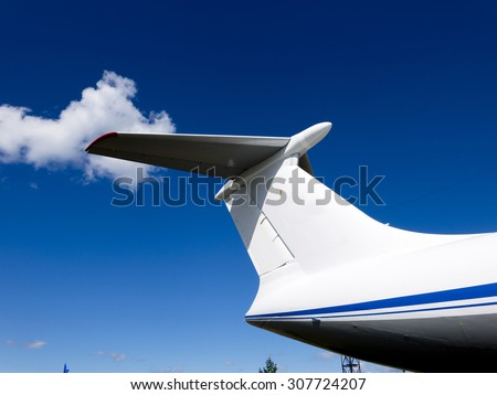 Details of the cargo and civilian aircraft. Best transport aircraft in the world. The tail of the plane. - stock photo