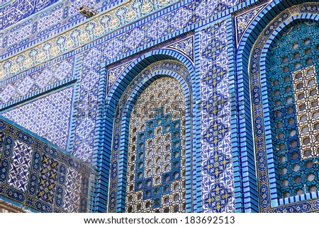Details of the ceramic tile pattern that covers the exterior of the base of the Dome Of The Rock shrine on the Temple Mount in the Old City of Jerusalem.  - stock photo