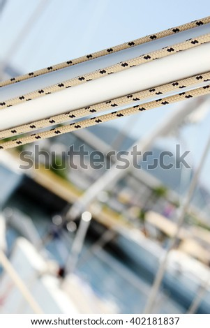 Details of the mast with ropes. Yacht marina - stock photo