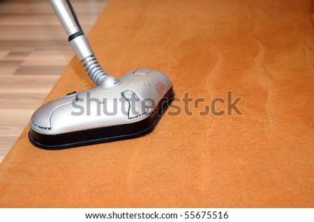 Details of the vacuum cleaner on a carpet. - stock photo