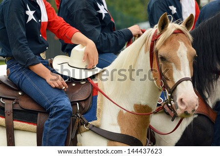 Details of Western Horse and rider with a cigarette - stock photo