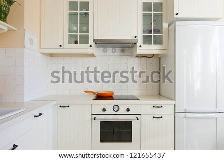 details of white modern kitchen in antique rustique style - stock photo