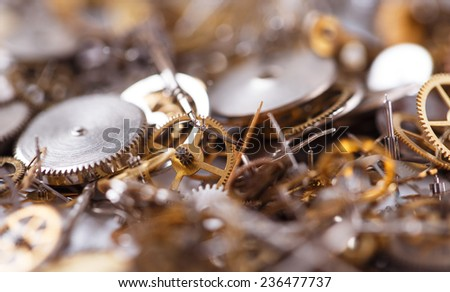 Details, technology. Heap of small gears on the table - stock photo