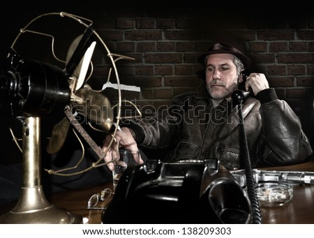 Detective examining evidences in his office - stock photo