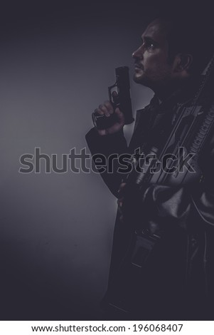 Detective, gangster with gun and pistol - stock photo