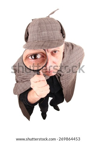 Detective investigates with magnifying glass - stock photo