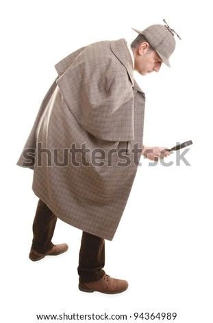 Detective Sherlock Holmes following tracks with magnifying glass - stock photo