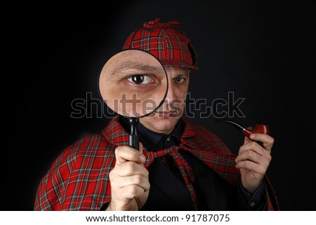 Detective Sherlock Holmes investigate with magnifying glass - stock photo