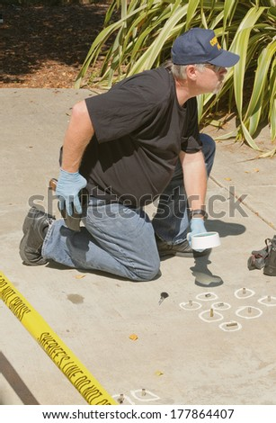 Detective studying a crimes scene  - stock photo