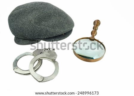 Detective Warm Cap, Retro Magnifying Glass and Real Handcuffs Isolated on White Background - stock photo