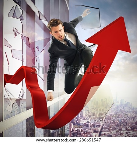 Determined businessman over a big red arrow - stock photo