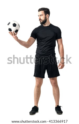 Determined challenging confident soccer player looking at the ball. Full body length portrait isolated over white background.  - stock photo