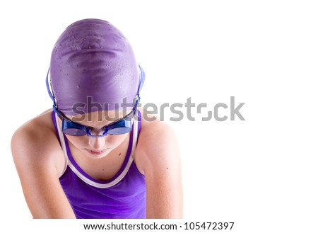 Determined young swimmer in dive pose - stock photo