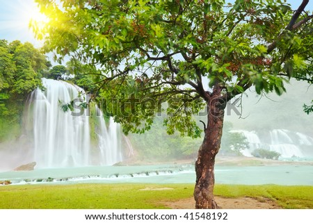 Detian and Ban Gioc waterfall along Vietnamese and Chinese board. - stock photo