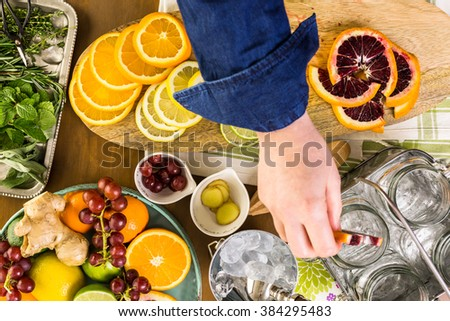 Detox citrus infused water as a refreshing summer drink. - stock photo