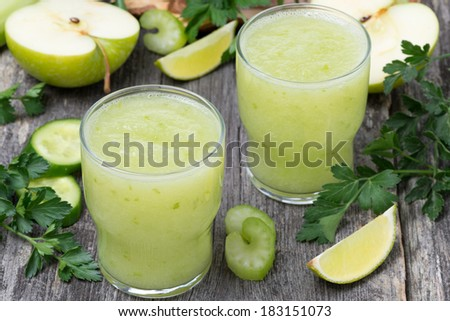 detox cocktail of green apple, celery and lime, top view, horizontal - stock photo