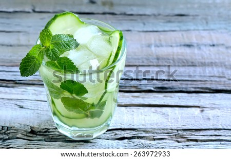 Detox cucumber and mint diet drink, healthy summer cooler - stock photo