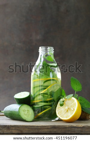 detox drink with fresh cucumber, lemon and ginger, healthy eating and diet - stock photo