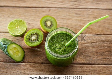 Detox green juice cleansing recipe with also kiwi lemon cucumber spinach - stock photo