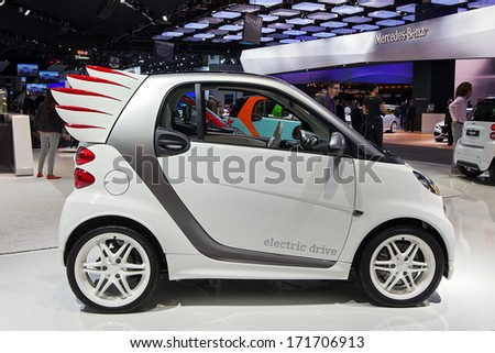 DETROIT - JANUARY 14 : A customized Smart car on display at the North American International Auto Show media preview  January 14, 2014 in Detroit, Michigan. - stock photo