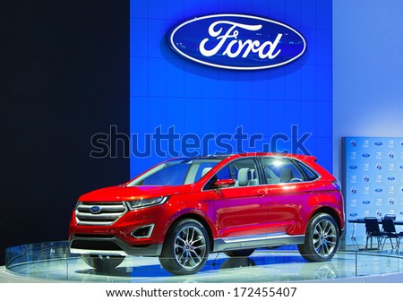 DETROIT - JANUARY 14 : A Ford Edge on display at the North American International Auto Show media preview  January 14, 2014 in Detroit, Michigan. - stock photo