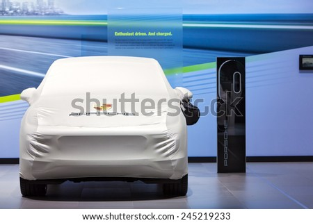 DETROIT - JANUARY 12: A Porsche Cayenne sits under wraps January 12th, 2015 at the 2015 North American International Auto Show in Detroit, Michigan. - stock photo