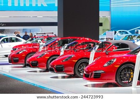 DETROIT - JANUARY 15: A row of Porsches on display January 13th, 2015 at the 2015 North American International Auto Show in Detroit, Michigan. - stock photo