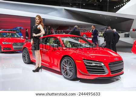 DETROIT - JANUARY 13: A show model poses with the Audi R8 on January 13th, 2015 at the 2015 North American International Auto Show in Detroit, Michigan. - stock photo
