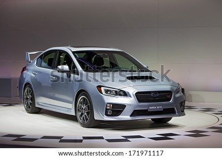 DETROIT - JANUARY 14 : A Subaru WRX STI on display at the North American International Auto Show media preview  January 14, 2014 in Detroit, Michigan. - stock photo
