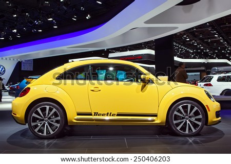 DETROIT - JANUARY 13: A Volkswagen Beetle on display January 13th, 2015 at the 2015 North American International Auto Show in Detroit, Michigan. - stock photo